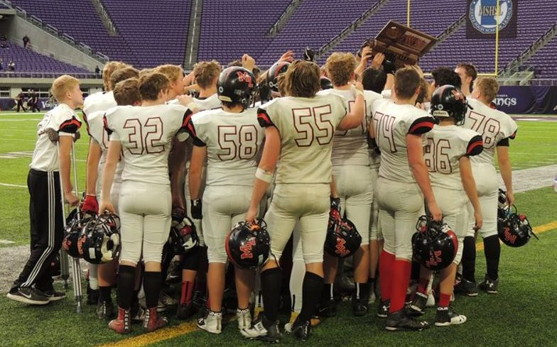 Crusader football team with their semifinal trophy
